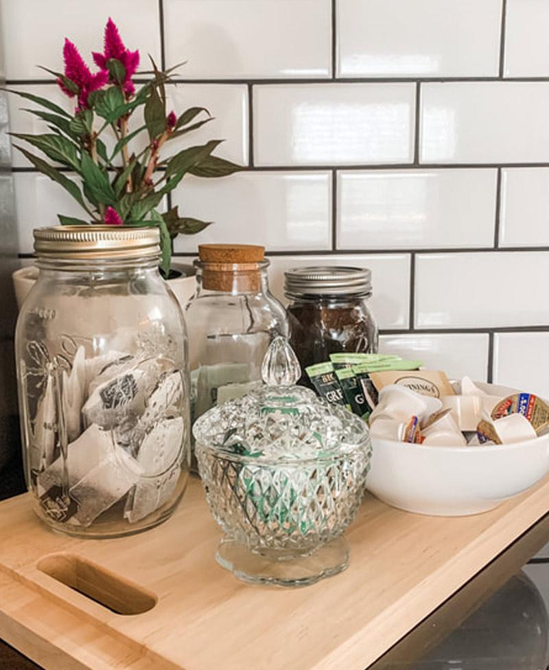 coffee condiments in mason jars on a butcher block